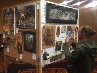 sometime Primal Spiral artist Andy Vanoverberghe completing display setup
