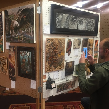 sometime Primal Spiral artist Andy Vanoverberghe completing display setup