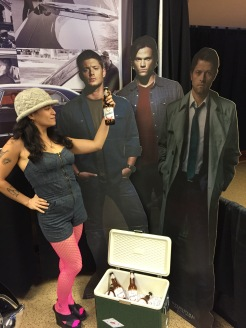 Eva L. Elasigue with images of Supernatural actors Jensen Ackles, Jared Padalecki, & Misha Collins. appreciating the beer.